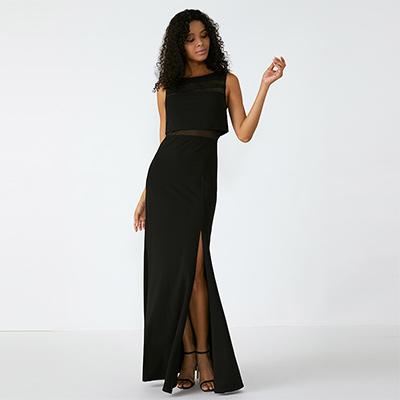 广州服装厂无袖圆领开衩拼接透视黑色连衣裙